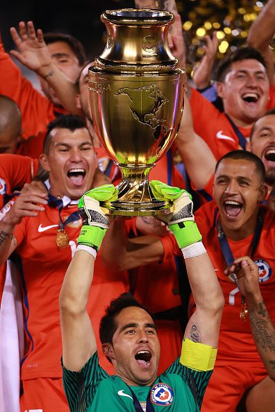 #COPA2016 #COPA100 Claudio Bravo goalkeeper of Chile lifts the trophy after winning the championship match between Argentina and Chile at MetLife Stadium as part of...