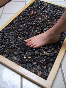 Love this! Wish my cat wouldn't pee on it! - DLGH how-to make your own stone bath mat from Natural Home. To make the mat, first you build a simple wooden frame, put a wire mesh across the bottom, and fill it with stones. It's like having a river bed in your bathroom.could place outside in front of hot tub steps.