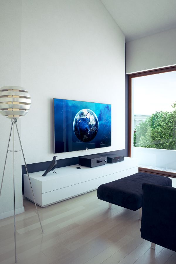 In the lounge, black furniture anchors the entertainment area that comes complete with flatscreen TV and media system. The television is mou...