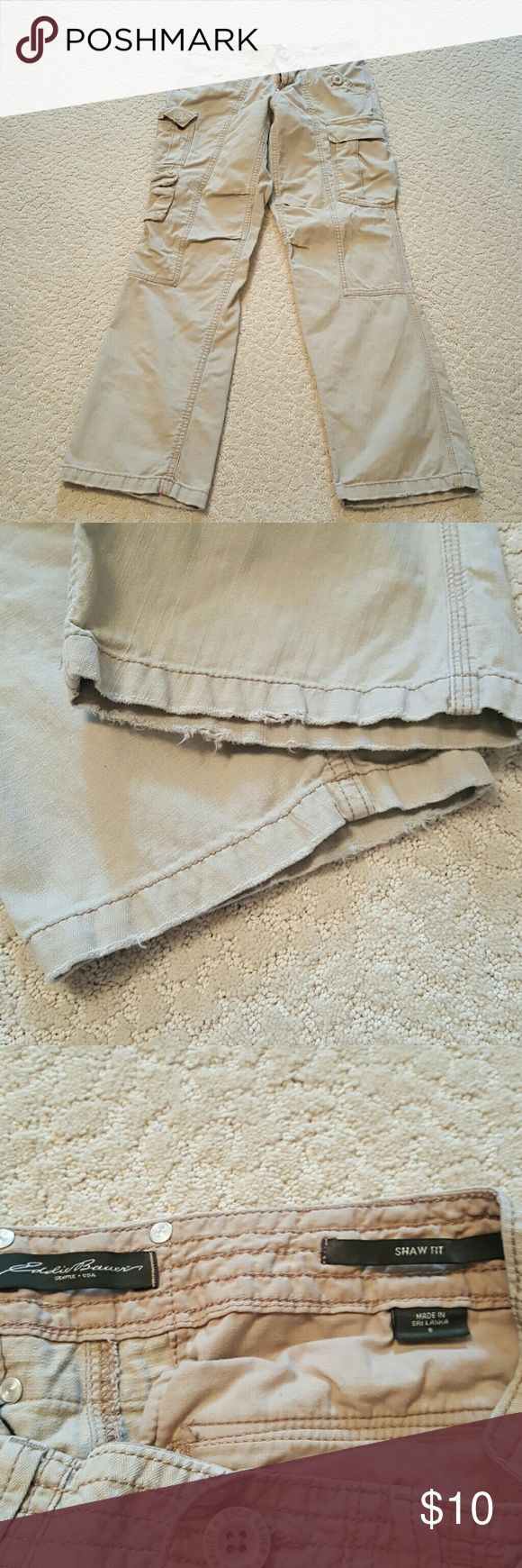 Womens Eddie Bauer cargo pants Womens Eddie Bauer tan cargo pants, size 6, Shaw fit, does show signs of wear at the bottom, slight fraying see pictures. Does fit a litter tighter in the thighs with this cut. In good condition. Eddie Bauer Pants Trousers