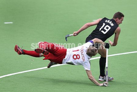 Barry Middleton of England and Alex Shaw of New Zealand during the match between England and New Zealand during day three of the Champions Trophy at State Netball Hockey Centre on December 4, 2012 in Melbourne, Australia.  (Photo by Michael Dodge/Getty Images)