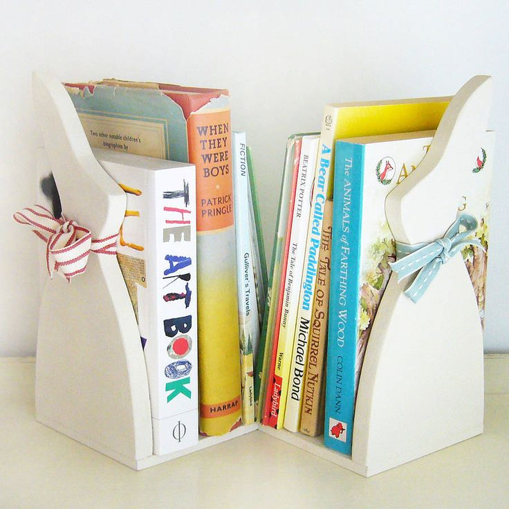 A beautiful pair of handmade and painted bunny bookends.A beautiful pair of duck bookends, hand-crafted and painted in our Cotswolds workshop. Each duck has it's own pretty ribbon neck-tie, one red stripe and one stitched duck egg ribbon. Each bookend is painted in Farrow & Ball Limewhite and will look wonderful on the bookshelf propping up all of your (or your children's!) favourite books! These bunnies are perfect for bedrooms, children's bedrooms and living rooms.Painted wood…