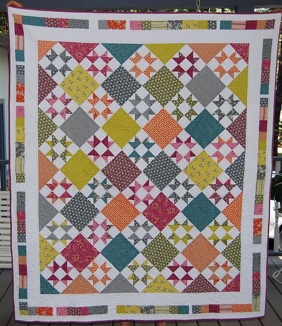 Fun use of the basic star block set on the diagonal...great use of color!