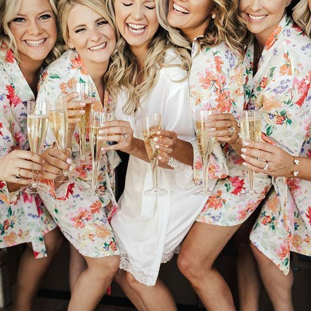Cheers!! 🍾 It's almost the weekend! The gorgeous bride wears our 'Touch of Lace' robe with her #bridesquad in our 'Bright Floral' robes 💕 LR xx