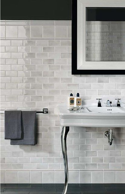Marble subway tile that looks like glass and hardwood or porcelain/ceramic floor tiles that look like wood. LOVE!