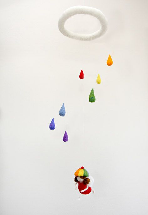 Some people are seriously talented ...  I love this, too.  Waldorf inspired needle felted mobile: Rainbow-rain gnome with crystal. Made by MagicWool, on Etsy.