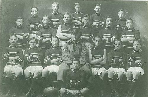 Football Team with leader in full military uniform 1915. 1900s football. Geelong, Australia.