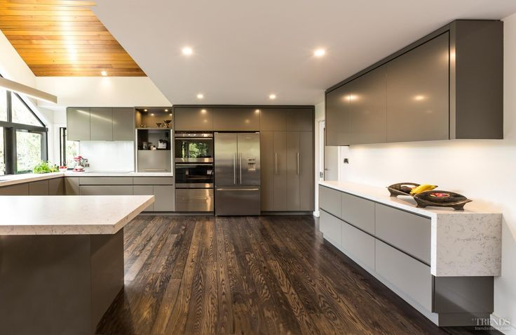 Contemporary new kitchen with warm neutral cabinets and quartz counter tops
