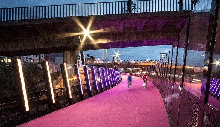 A stretch of unused highway has been transformed into a bright pink cycleway in the central business district of Auckland, New Zealand.