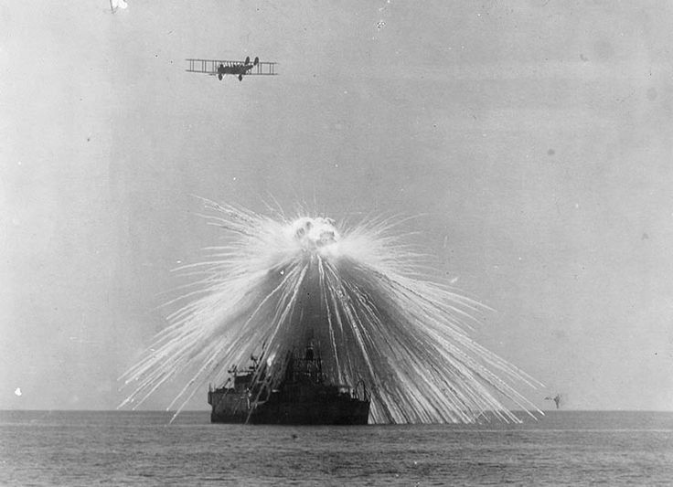 USS Alabama hit by a white phosphorus bomb dropped by an NBS-1 in bombing tests, September 1921.