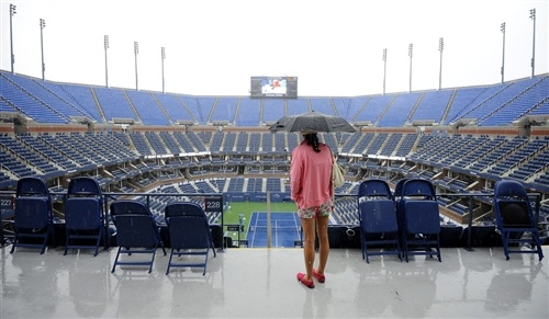 Soggy, wet start to the US Open Tennis Tournament (Photo: Larry W. Smith / EPA)