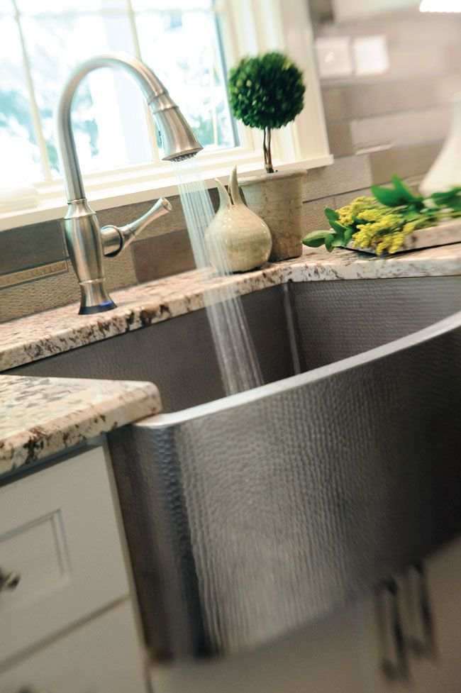 Hammered farmhouse sink adds character to the kitchen.