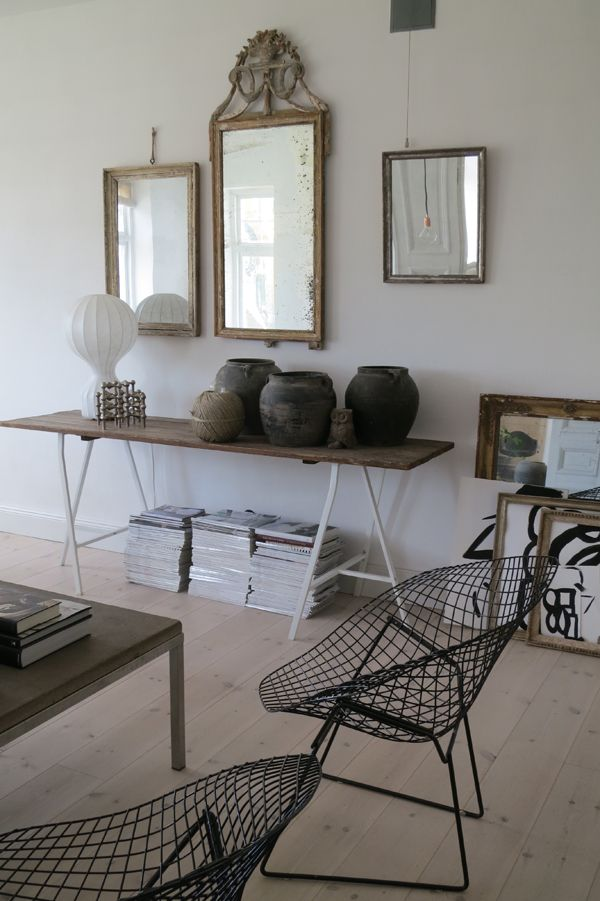 rustic mirrors (love the offset) and pots opposite modern table/chairs = visual swag :)