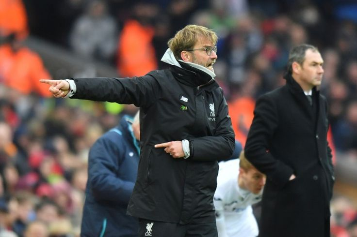 Klopp laments passive defending Liverpool after Swansea shock   Liverpool (AFP)  Liverpool manager Jurgen Klopp berated his sides passive defending after a 3-2 loss at home to Swansea dealt a major blow to their Premier League title hopes.  Relegation-threatened Swansea became the first away team to win a league fixture at Anfield for more than a year as Fernando Llorente scored twice on Saturday before Gylfi Sigurdsson struck the winner 16 minutes from time.  Once again Liverpool looked…
