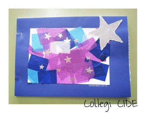 Portada 1r trimestre. Collage de paper de seda, gomets d' estrelles i estrella punxada de cartolina platejada. 3 anys
