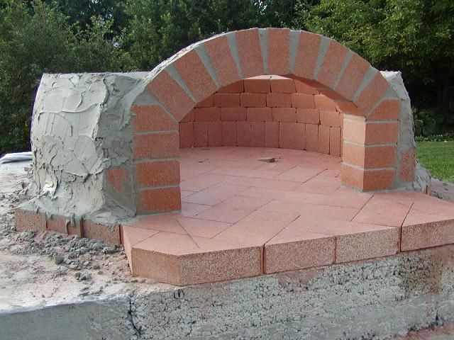 """Now that the two part slab is done, it's time to lay out the oven floor. Having already determined that my oven diameter is 38,"""" I mark a center line and begin to lay the bricks. Someth…"""