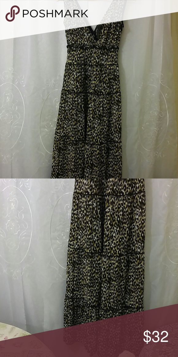 Tiger print dress Flowy and soft, with a v neck back and front. stile and company Dresses Maxi