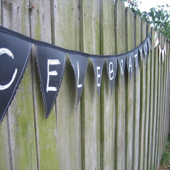 Chalkboard fabric pennant banners! (I wonder what is used for the fabric. Faux leather?)