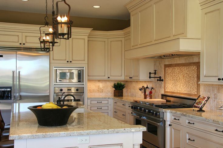 Antique cream glazed cabinets with quartz countertops for White kitchen cabinets with crown molding