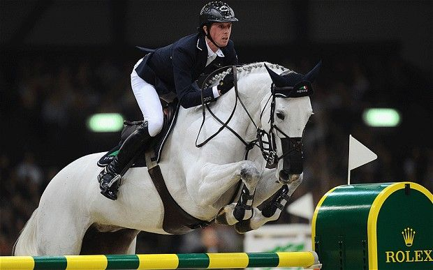 Olympic show-jumping champion Ben Maher on Cella. The mare suffers from head shaking, so he makes sure to put a net over her nose and keep it moist so no bugs, dust or allergens irritate her.