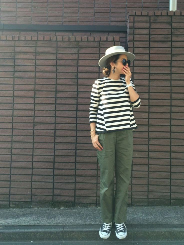 Hat, striped top, olive pants, sneakers.