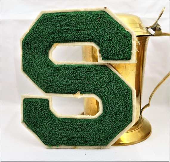 Letterman Patch, Letter S, Pennsylvania Letterman Memorabilia, Chenille, Green and Cream, Vintage Accessories. Measures 6 1/2 x 5 1/2. Chenille fabric and iron on backing. This is an green and cream, letter S, letterman patch out of Pennsylvania. Trimmed in cream and attached to an