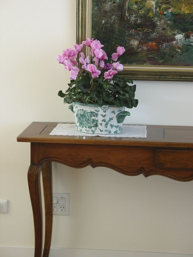 Beautiful curves and detail on the bordeaux style french provincial beautiful curves and detail on the bordeaux style french provincial side table the pink flowers look great on the dark polished wood french pro watchthetrailerfo