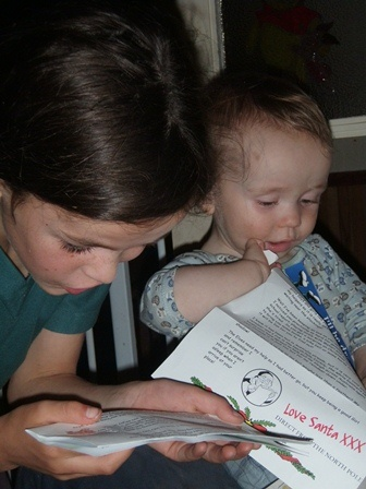 Girl and baby looking at Love Santa letters together - a simple pleasure to enjoy with others :)