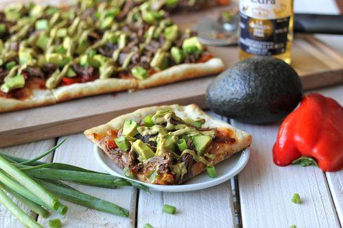 carnitas avocado pizza with chipotle avocado mayonnaise drizzle -from damn delicious