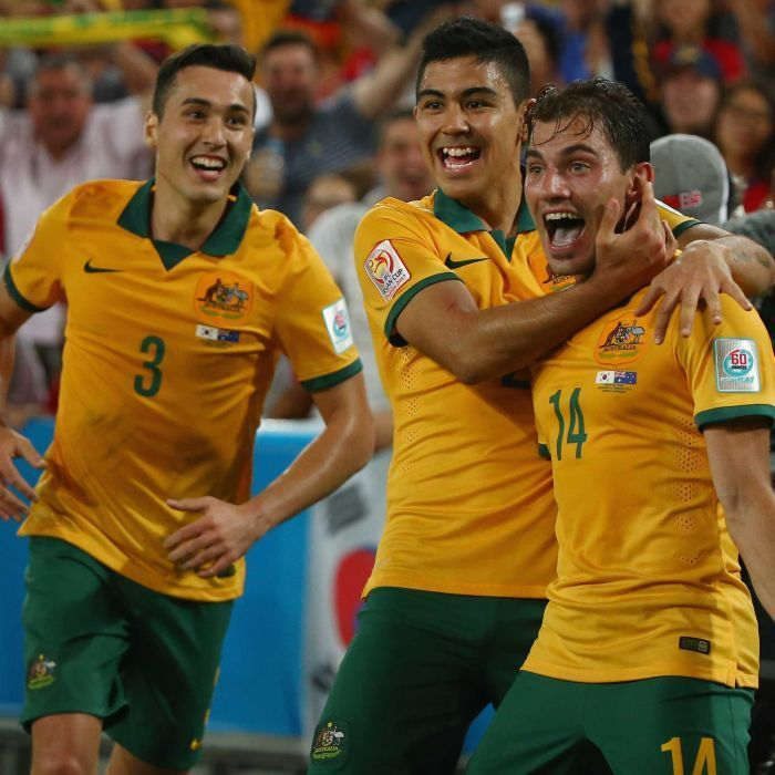 Socceroos celebrate Troisi's goal in Asian Cup final - James Troisi of Australia celebrates with his team-mates after scoring a goal during the 2015 Asian Cup final match against South Korea at Stadium Australia on January 31, 2015 in Sydney.