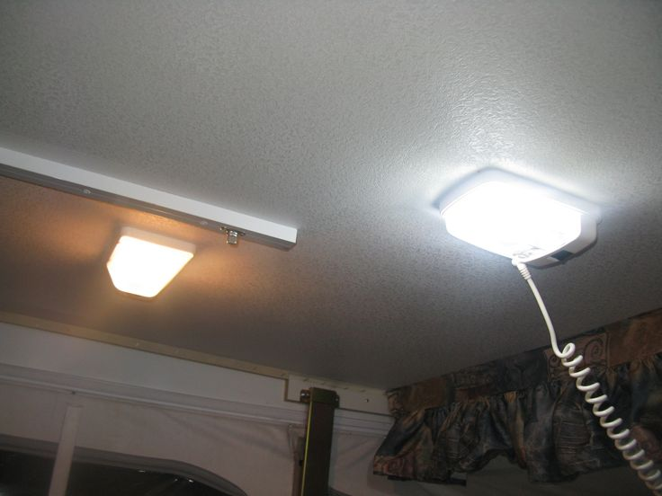 LED light in camper vs regular light.  www.apocketfullofscrews.com