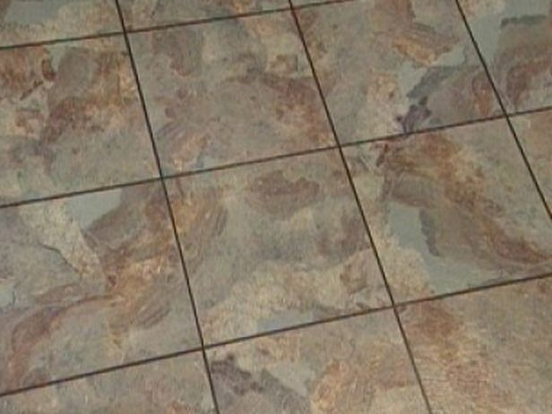 How to Install Vinyl Flooring That Looks Like Slate How To DIY Network  17  images. Laying Vinyl Flooring On Tiles