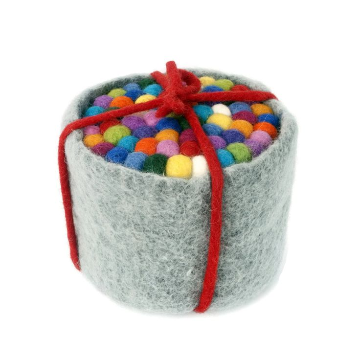 This gorgeous set of six coasters comes in our unique felt pot to store the coasters when not in use. The coasters are made using 1.2cm felt balls and are approximately 10cm in diameter.Great as a gift, these sets come tied with our felted wool string. Just select your pot colour when ordering.