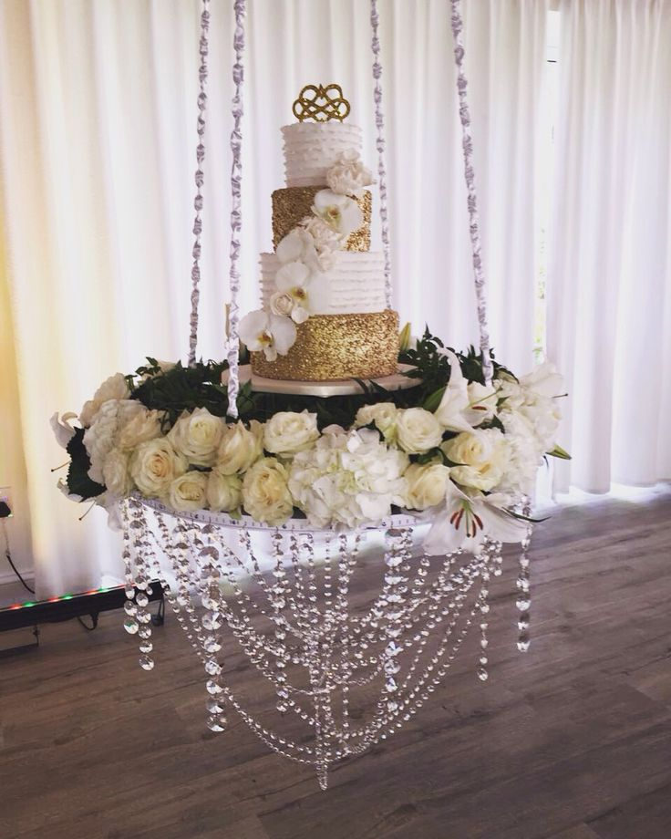 Suspended cake table with hanging crystals   Wedding