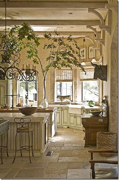 The rough stone floors...light rustic beams and artistic treatment of the small tree limb in glass.....great vignette