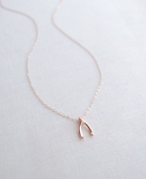 Dainty Wishbone Necklace by Olive Yew. Small wishbone charm is available in gold, silver or rose gold.