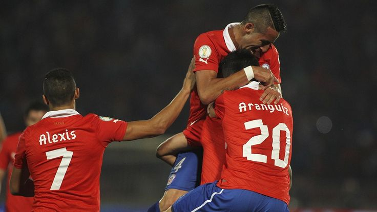 SANTIAGO, CHILE - SEPTEMBER 06: Chile's player Eduardo Vargas celebrates after scoring during a match against Venezuela as part of the 15th round of the South American Qualifiers at Nacional Stadium on September 06, 2013 in Santiago, Chile. (Photo by Jose Perez/LatinContent/Getty Images)