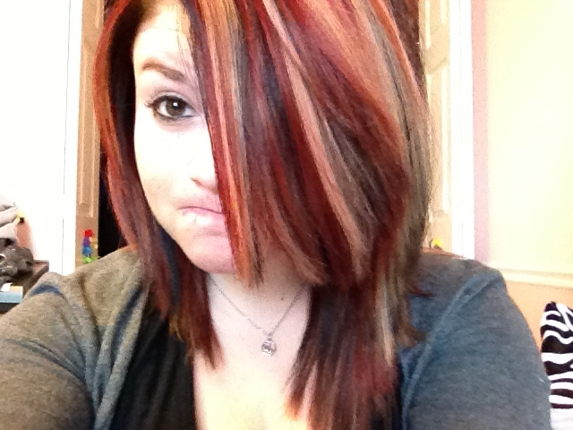 Short Black Hair With Red And Blonde Highlights.