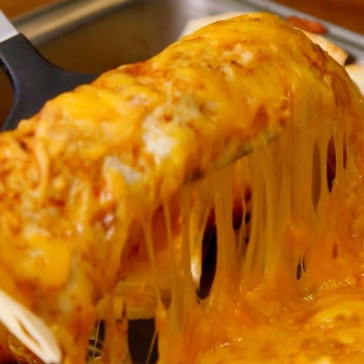 Behold the delicious glory of Slow Cooker Wet Burritos. Throw the beef into a slow cooker until it's cooked to...