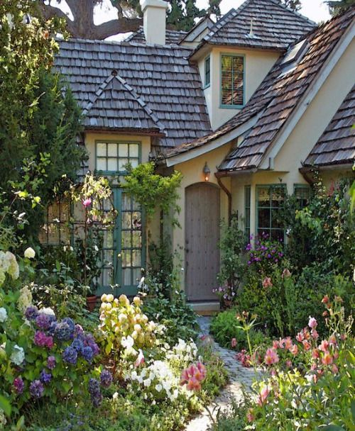 Adorable cottage surrounded by a fairytale garden