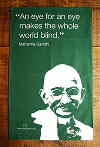 """Mahatma Gandhi tea towel """"An eye for an eye makes the whole world blind."""" Gandhi (1869-1948) was the political and ideological leader of India during the Indian independence movement inspiring movements for civil rights and freedom across the world."""