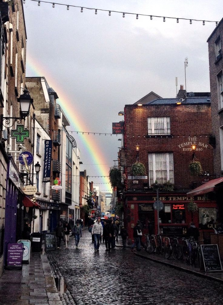 The luck of the Irish! Love that there's a rainbow in the background!! Dublin, Ireland.