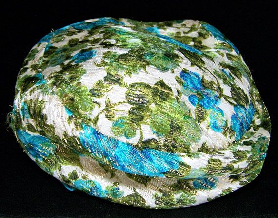 Vintage 1960s blue green ladies hat Blue and green flowers with gold metallic thread woven through, blue grosgrain ribbon with bow Lined in tan grosgrain fabric Inside diam... #gotvintage #fabric