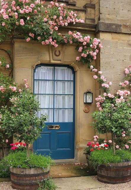 Blue front door with roses at Chatsworth