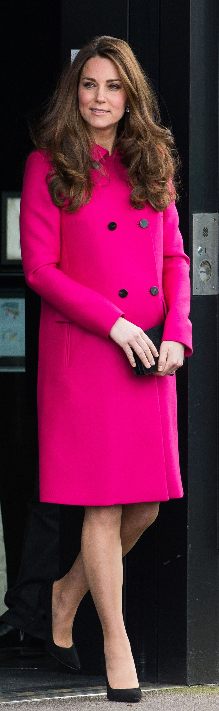 Kate Middleton wearing a hot pink Mulberry coat that she's worn before!