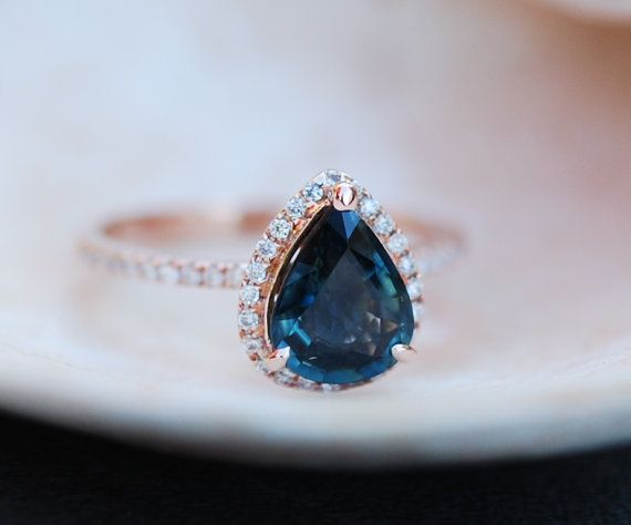 The ring features 1.6ct Peacock Blue Green sapphire. The stone is eye clean and sparkling, natural untreated sapphire.  Size 6  Details: Main