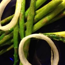 """Pan-Fried Asparagus with Onions. """"Everyone that I make this for absolutely loves it! The onions are a great flavor contrast to the asparagus. This vegetable dish pairs as a great side with everything...fish, meat, chicken, or pasta."""""""