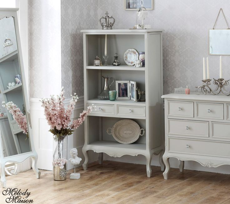 Elise Grey Range- Bookcase with Drawers Ornate distressed grey painted Bookcase With 2 drawers placed at a convenient height. This clever design feature which will save too much bending over when rummaging through drawers! Other items in this range