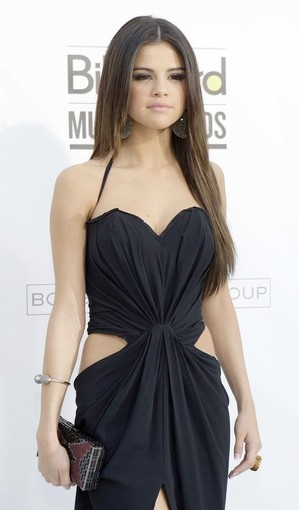 Selena Gomez, she looks cute in this outfit.