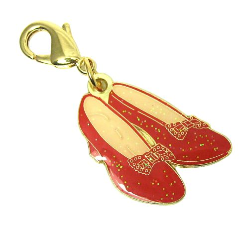 Ruby Slippers charm gold plated detailing with red enamel glitter infill, 95p each. #pingame #pins #rubyslippers #wizardofoz #design #enamelpins #glittery #pingamestrong